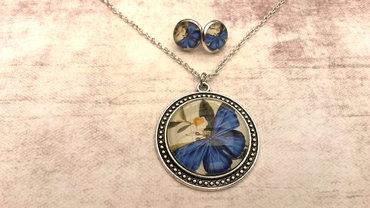 Handgemaakte ketting met blauwe vlinder